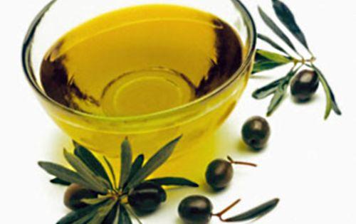 Bowl of Olive Oil --- Image by © J.Garcia/photocuisine/Corbis